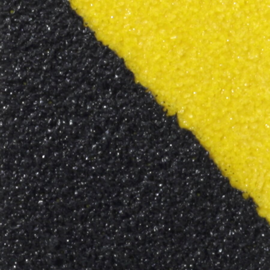 Černo-žlutá korundová protiskluzová páska FLOMA Hazard Standard - délka 18,3 m, šířka 2,5 cm a tloušťka 0,7 mm