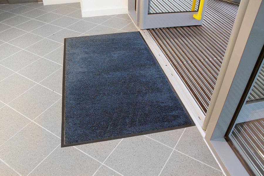 Modrá textilní vstupní vnitřní čistící rohož - délka 85 cm, šířka 120 cm a výška 0,9 cm