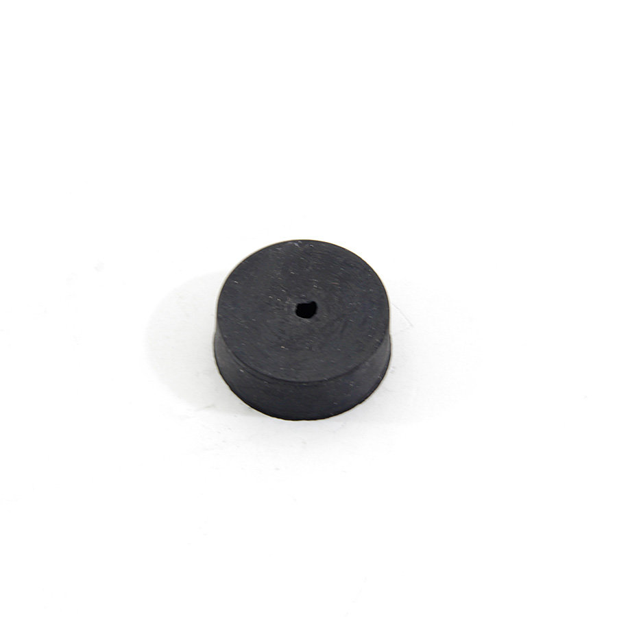 Černý pryžový válcový doraz s dírou pro šroub FLOMA - průměr 3 cm a výška 1 cm