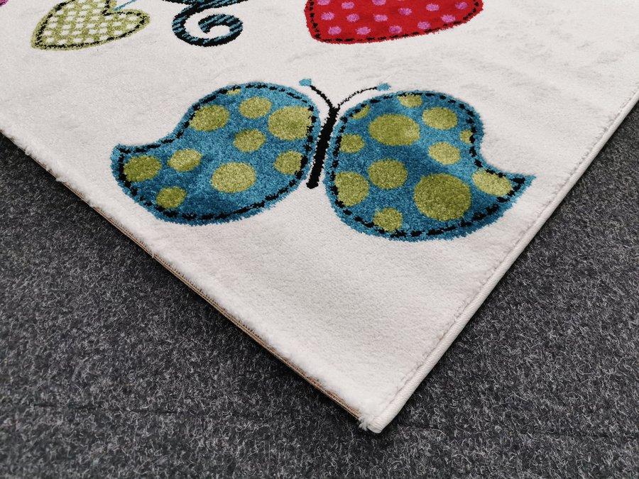 Různobarevný kusový dětský koberec - délka 170 cm a šířka 120 cm