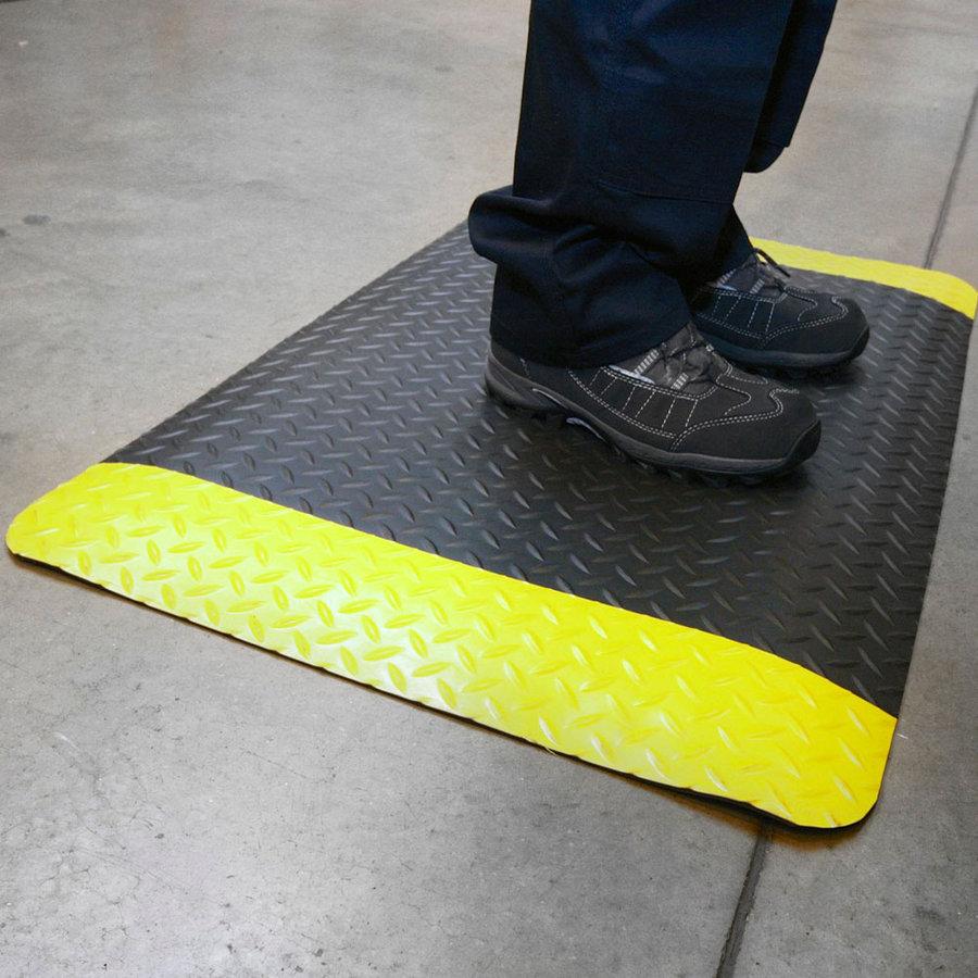 Černo-žlutá protiúnavová průmyslová laminovaná rohož - délka 90 cm, šířka 60 cm a výška 1,4 cm